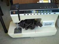 Used Singer Athena 2000 Sewing Machine with over 20