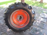 2 utilized tractor tires and rims and tubes. Lots of
