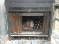It's a used wood burning fireplace recently removed to