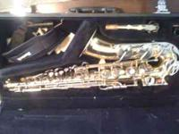 Yamaha Alto Saxaphone. Paid 2,000 for it 5years ago.