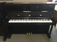 A piano with a warm and cheery tone this used upright