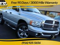 Our eye-catching 2005 Dodge Ram 1500 SLT Quad Cab comes