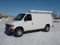 This 2006 Ford E-250 two door two wheel-drive FORD E250