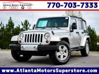 Our 2010 Jeep Wrangler Sahara 4x4 delivers both