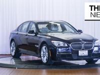 Here is a clean fresh trade in 2014 BMW 750i M Sport in