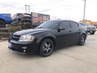 Look at this 2014 Dodge Avenger R/T. Its Automatic