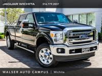 2015 Ford F-250SD Lariat, located at Land Rover of