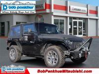 Our Accident-Free 2015 Jeep Wrangler Sport 4WD, shown