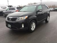 Our 2015 Kia Sorento has AWD, back up camera, traction