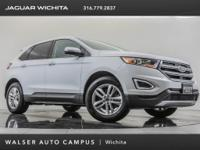 2016 Ford Edge SEL, located at Land Rover of Wichita.