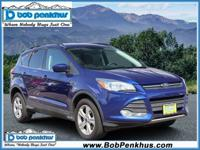 Our 2016 Ford Escape SE 4WD is shown off in Deep Impact