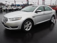 Silver 2016 Ford Taurus SEL FWD 6-Speed Automatic with