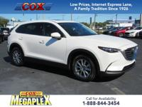 This 2016 Mazda CX-9 Touring in Snowflake White Pearl