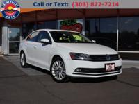 Presented in Pure White, our 2016 Volkswagen Jetta SEL