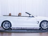 Here is a 2019 BMW 430i Convertible with only 7,212