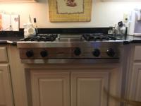 "Stainless Viking 36"" gas cooktop. 4 large burners with"