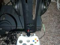 Used black xbox 360 1st generation. Service warranty