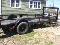 14 ft trailer with 12 ft hauling space and 2 ft cargo