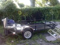 Black lawn maintenance trailer you can use to pull