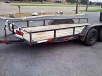 16 ft trailer. ZNew tires, Lights, Built in ramps,