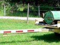 Utility trailer w/ long tongue, 20' overall length. Bed