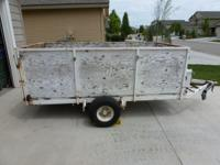Utility Trailer 4 1/2' X 9' With ramp tail gate. In