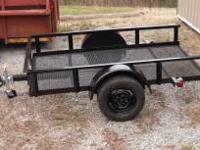 5x8 UTILITY TRAILER THAT TILTS & WITH JACK. Contact