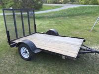 5X7 Utility trailer with pull down ramp. less than two