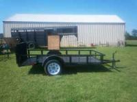 New black 6x10 trailer, treated wood floor, dove tail