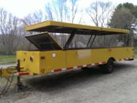 Lots of Storage, Pop Up and Latch Top, Solid Trailer