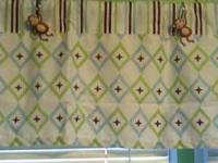 Two matching valances that coordinate with the Little