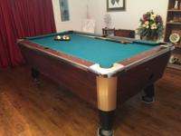 This is a pool table comes with the balls and the rack.