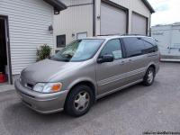 7 Passenger ,tan,loaded,104,000 miles,new