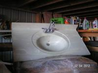 I have a used bathroom vanity countertop and faucet. It