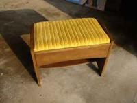 Vanity stool with storage drawer. Does have a knick in