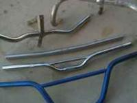 Up for sale are 5 handlebars and two bicycle stems.