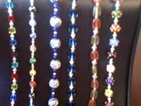 Many glass & STERLING SILVER beaded bracelets. Prices