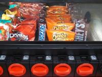 Great table top vending machine hold 5 different items.