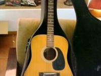 Vintage 70's ventura acoustic guitar with case. Plays