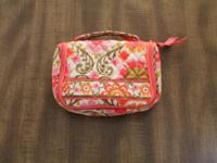 Mini cosmetic organizer with hanging hook. The bag has