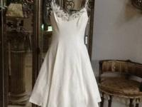 This is a brand new Vera Wang cream color dress. It is