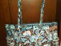 """get carried away tote"" in java blue. Used as a diaper"
