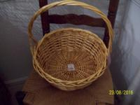 "Round Willow Basket from Burton + Burton. 5 1/2"" H X 12"