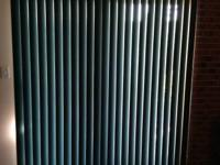 "Forest Green vertical blinds. 76"" wide X 80"" long"