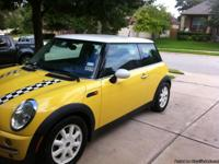 This stunning Mini is yellow with unique black