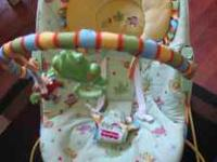 VERY CUTE BABY BOUNCER 20.00 IT WORKS GREAT BUT IS