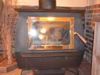 Eight year old Blaze King Wood burning stove. Excellent