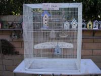 very nice bird cage it has ( 2 ) large doors and (6)