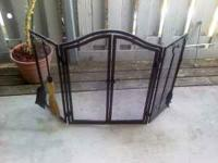 Very nice black iron fireplace set....Screen protector