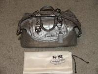 Coach satchel design handbag is pewter gray, with hand